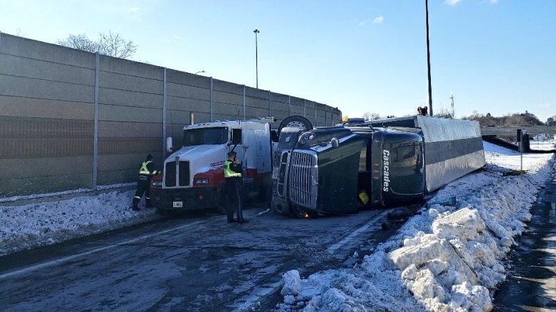 Police respond to a vehicle rollover on the Highway 8 ramp in Kitchener (Twitter: @OPP_HSD)