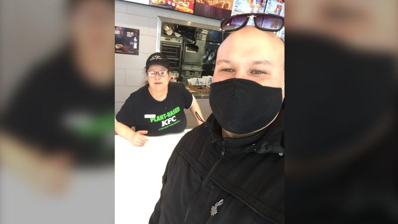 Jason Schweitzer is seen with Emilia, a Toronto-based KFC employee who is the subject of a GoFundMe campaign that's raised more than $17,000. (Supplied)