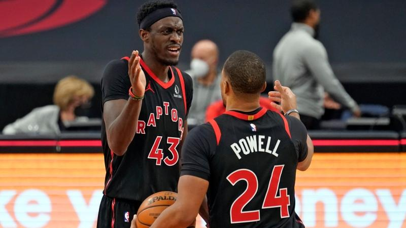 Toronto Raptors forward Pascal Siakam (43) celebrates with guard Norman Powell (24) after the team defeated the Philadelphia 76ers during an NBA basketball game Sunday, Feb. 21, 2021, in Tampa, Fla. (AP Photo/Chris O'Meara)