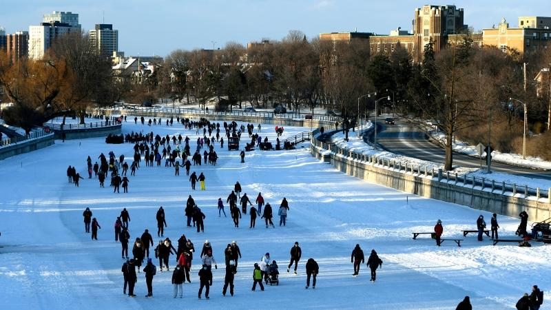 People practice physical distancing as they skate on the Rideau Canal Skateway in Ottawa, on the first weekend of Winterlude, Saturday, Feb. 6, 2021. The winter festival, which usually features artistic performances, an ice carving competition and a park transformed into a winter playground, is being held virtually this year due to the COVID-19 pandemic. (Justin Tang/THE CANADIAN PRESS)