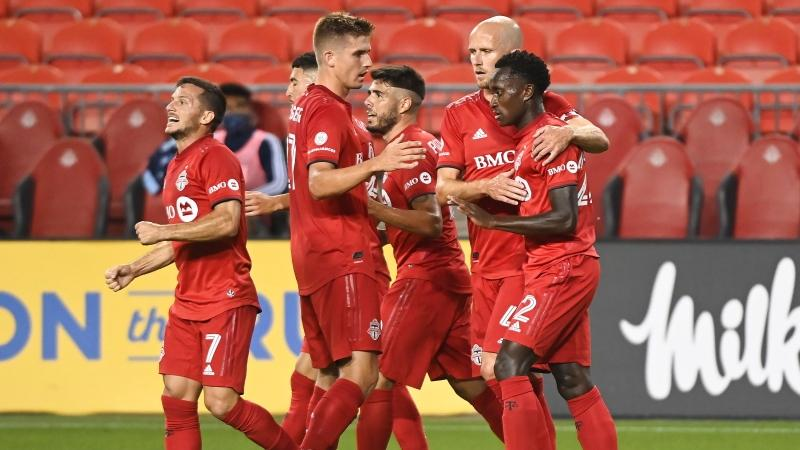 Toronto FC midfielder Richie Laryea (22) celebrates his goal with Toronto FC midfielder Michael Bradley (4) while Playing against the Vancouver Whitecaps during first half MLS Canadian Championship soccer action in Toronto on Friday, August 21, 2020. THE CANADIAN PRESS/Nathan Denette