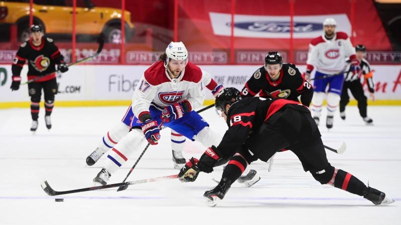 Ottawa Senators left wing Tim Stutzle (18) knocks the puck away from Montreal Canadiens right wing Josh Anderson (17) during first period NHL action in Ottawa on Tuesday, Feb. 23, 2021. THE CANADIAN PRESS/Sean Kilpatrick