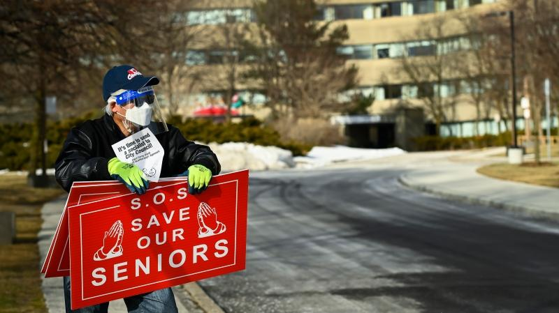 A man protests outside the Tendercare Living Centre long-term-care facility during the COVID-19 pandemic in Scarborough, Ont., on Tuesday, December 29, 2020. This LTC home has been hit hard by the coronavirus during the second wave. THE CANADIAN PRESS/Nathan Denette