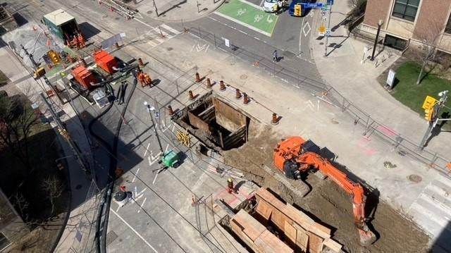 Crews work to repair a downtown Toronto road after a sewer collapsed, creating a sinkhole. (Twitter/TOTransportation)