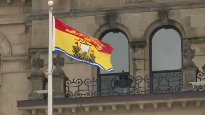 The New Brunswick flag flies outside the provincial legislature in Fredericton on Dec. 19, 2019.