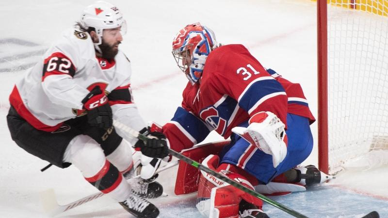 Montreal Canadiens goaltender Carey Price stops Ottawa Senators' Clark Bishop during third period NHL hockey action in Montreal, Saturday, April 3, 2021. THE CANADIAN PRESS/Graham Hughes