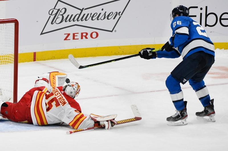 Calgary Flames goaltender Jacob Markstrom (25) makes a save on Winnipeg Jets' Blake Wheeler (26) during the shootout in NHL action in Winnipeg on Monday Feb. 1, 2021. THE CANADIAN PRESS/Fred Greenslade