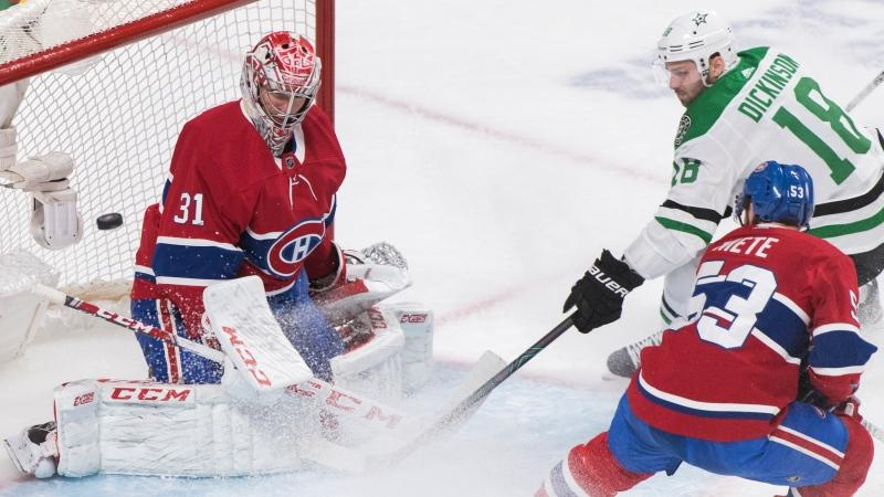 Dallas Stars' Jason Dickinson (18) moves in on Montreal Canadiens goaltender Carey Price as Canadiens' Victor Mete (53) defends during second period NHL hockey action in Montreal, Saturday, February 15, 2020. THE CANADIAN PRESS/Graham Hughes