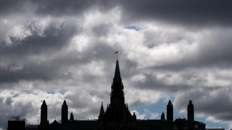 Clouds pass by the parliament buildings Wednesday August 19, 2020 in Ottawa. (Adrian Wyld/THE CANADIAN PRESS)