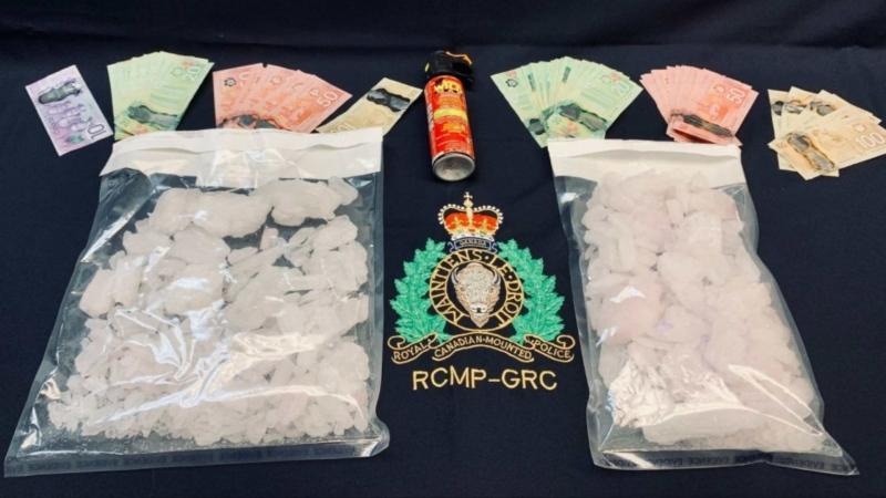 According to police, officers seized quantities of crystal methamphetamine and money as a result of the search. (Photo courtesy: RCMP)