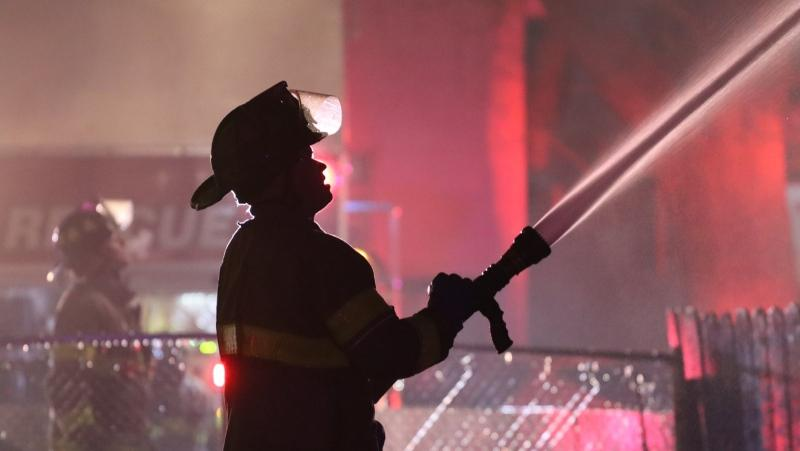 Windsor Fire and Rescue Service crews battled an upgraded house fire on Janette Avenue in Windsor, Ont. on Friday, March 12, 2021. (courtesy OnLocation)