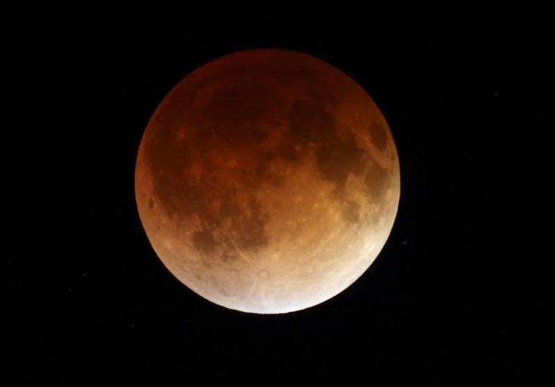 The moon glows a red hue during a total lunar eclipse Tuesday, April 15, 2014, as seen from the Milwaukee area. (Milwaukee Journal-Sentinel / Mike De Sisti / AP)
