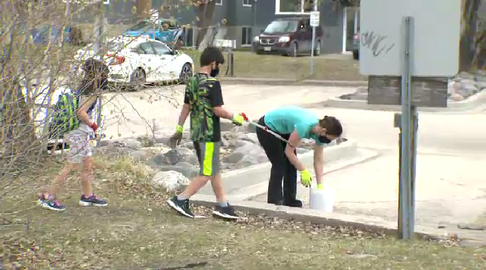 Volunteers pick up garbage during a community cleanup, May 1 (Source: Dan Timmerman)