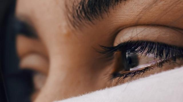 Stock image of a shallow focus of a person's eyes. (Unsplash, Luis Galvez)