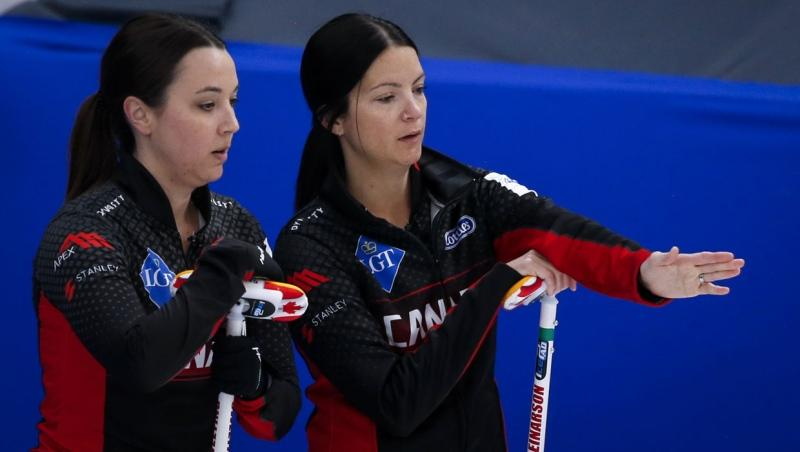 Canada skip Kerri Einarson, right, and third Val Sweeting discuss strategy against Switzerland at the Women's World Curling Championship in Calgary, Alta., Saturday, May 1, 2021.THE CANADIAN PRESS/Jeff McIntosh