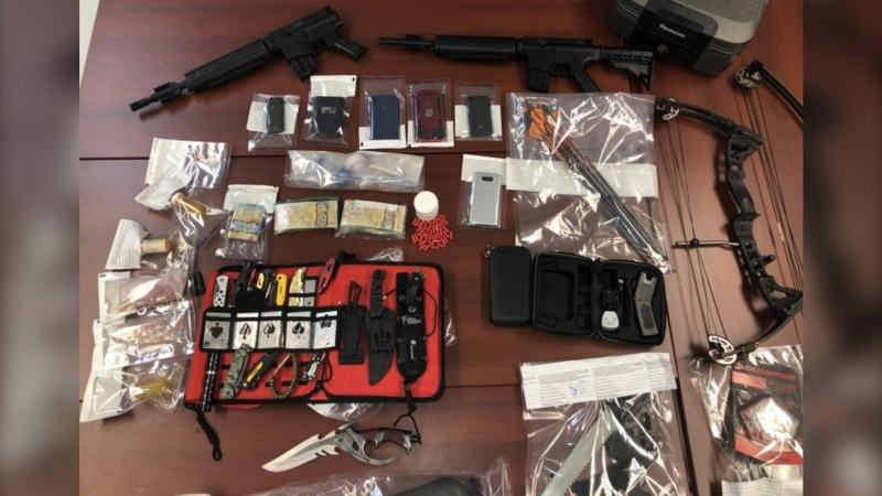 A photo supplied by police appears to show a compound bow in addition to the seized items they listed. (Photo: New Brunswick RCMP)