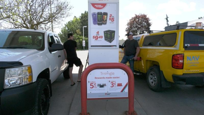 Addison Boucher (left) filling his truck with gas in Ottawa. May 17, 2021. (Dave Charbonneau / CTV News Ottawa)
