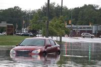 Heavy rain floods McHugh St. leading to the WFCU Centre