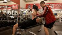 Trainer Tim Martin spots Paula Moors as she works on her incline dumbbell press, part of her personalized training plan at the GoodLife Fitness club in Dartmouth, N.S. on Friday, Dec. 30, 2011.