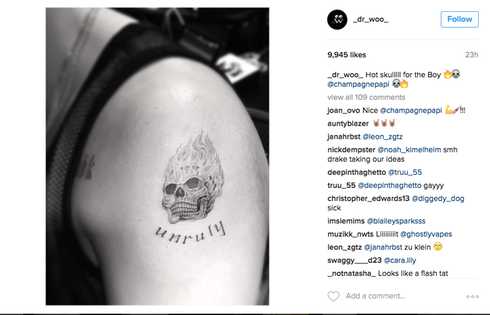587ef4043 Twitter Is Roasting Drake For His New Flaming Skull Tattoo