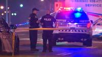 Police officers on scene of shooting on Eglinton Avenue and Sloane Avenue