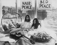 Beatle John Lennon (1940 - 1980) and his wife of a week Yoko Ono in their bed in the Presidential Suite of the Hilton Hotel, Amsterdam, 25th March 1969. The couple are staging a 'bed-in for peace' and intend to stay in bed for seven days 'as a protest against war and violence in the world'.