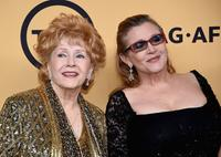 Actresses Debbie Reynolds (L), recipient of the Screen Actors Guild Life Achievement Award, and Carrie Fisher pose in the press room at the 21st Annual Screen Actors Guild Awards at The Shrine Auditorium on January 25, 2015 in Los Angeles, California.