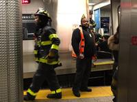 A commuter train derails at Brooklyn's Atlantic Terminal in New York City.