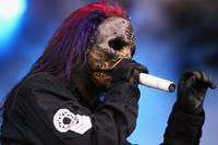 Corey Taylor of Slipknot performs on stage on at the third and final day of this year's Download Festival at Donington Park, Castle Donington on June 12, 2005 in Leicestershire, England. The annual rock festival features over 90 acts on three stages over three days.
