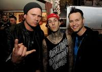 (L-R) Musicians Tom DeLonge, Travis Barker and Mark Hoppus of blink-182 pose at a press party of announce the 2011 Honda Civic Tour featuring blink-182 and My Chemical Romance at the Rainbow Bar and Grill on May 23, 2011 in West Hollywood, California.