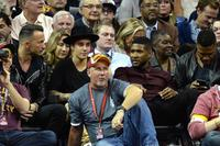 Singers Justin Bieber (2nd L) and Usher look on during a game between the Cleveland Cavaliers and the New York Knicks at Quicken Loans Arena on October 30, 2014 in Cleveland, Ohio. NOTE TO USER: User expressly acknowledges and agrees that, by downloading and or using this photograph, User is consenting to the terms and conditions of the Getty Images License Agreement.