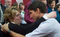 Prime Minister Justin Trudeau embraces Buckhorn, ON resident Kathy Katula following an emotional question about hydro rates at a town hall meeting in Peterborough, ON.