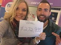 Lindsay Benoit and Ryan Barton hold up the final total from the 12 hour IWK Radiothon