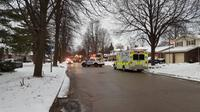 Emergency crews block the scene of a house fire on Griffith Street in London, Ont, on Monday, February 13, 2017.