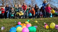 Children rush a field full of Easter Eggs, candy and other goodies Saturday March 30, 2013 during the Mix 106 Easter Egg Scramble at Julia Davis Park in Boise, Idaho.