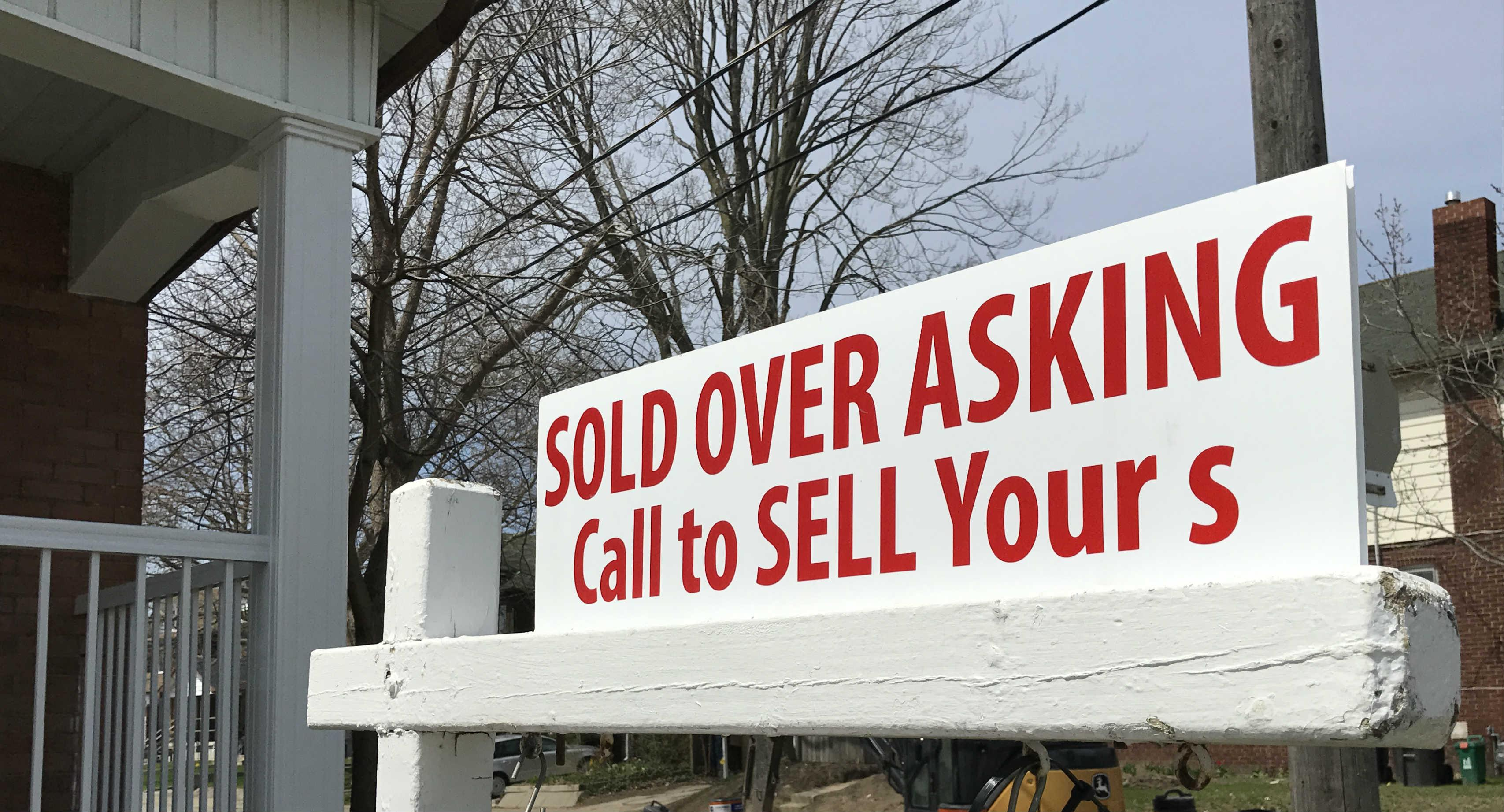 Real estate sold over asking lawn sign