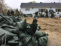 Canadian soldiers prepare sandbags for Laval residents