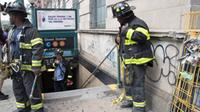 Emergency crews help after a new York City subway derailed June 27, 2017.