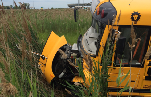 School bus on route to summer camp collides with 18-wheeler