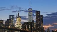 In this Aug. 19, 2016 photo, the lower Manhattan skyline, including One World Trade Center and the Brooklyn Bridge, are shown in New York. (AP Photo / Mark Lennihan)