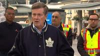 Mayor John Tory making an announcement at Yonge-Dundas Square about a cleaning blitz.