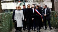 French President Emmanuel Macron pays respects to the 17 people killed when Islamic extremists attacked Charlie Hebdo newspaper and a kosher supermarket three years ago.