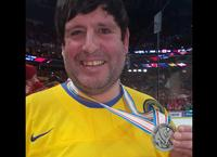 Bill Shaflucas caught the silver medal thrown over the glass by team Sweden captain Lias Andersson after the 2018 IIHF World Junior Hockey Championship in Buffalo.