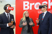 Brock University President Gervan Fearon, left, and Ontario Minister of Research, Innovation and Science Reza Moridi, right, listen as Cool Climate Oenology and Viticulture Institute Director Debbie Inglis explains the virtual reality technology they're trying out. Moridi was at Brock Monday, Jan. 8 to announce $137 million in funding for Ontario universities through the Ontario Research Fund, which includes nearly $1 million to develop a first-of-its-kind sensory lab at Brock.