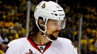 In this May 16, 2017, file photo, Ottawa Senators' Erik Karlsson prepares for a face-off during the second period of Game 2 of the Eastern Conference finals against the Pittsburgh Penguins, in Pittsburgh. Senators captain Erik Karlsson has no timetable to get back on the ice or play following offseason foot surgery. (AP Photo/Gene J. Puskar, File)