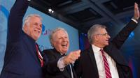 Quebec Premier Philippe Couillard, from the left, former Quebec premier Jean Charest and former Quebec Liberal Party interim leader Jean-Marc Fournier wave to supporters at the 150th anniversary celebrations of the Quebec Liberal Party Saturday,