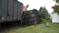 The two toppled train cars that crashed through Jim Clark's garden and part of his back yard just after ten o'clock Tuesday morning were carrying carbon black, which is used in the manufacturing of tires. (CTV Atlantic photo)