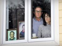 Larry Fairholm and ex-wife Tracy Wing in the front window of her home in Lac-Brome, where she keeps photos of their son, Riley Fairholm. JOHN MAHONEY / MONTREAL GAZETTE