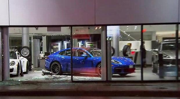 The damage after a car smashed through the window of a Toronto Porsche dealership