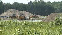 A 77-year-old man died after the crane he was operating toppled into a pond at a gravel pit on McCully Road in Augusta Township on Monday, July 17, 2017. (CTV Ottawa)